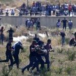 اسرائیلی جارحیت کے خلاف  مقبوضہ  بیت المقدس میں فلسطینی مسلمانوں کا احتجاج